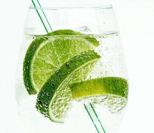 A glass of sparkling water with lime